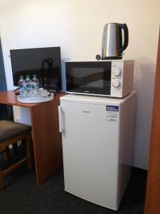 A television and/or entertainment center at Penzion Axa