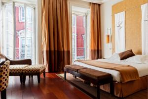 A bed or beds in a room at Heritage Avenida Liberdade - Lisbon Heritage Collection