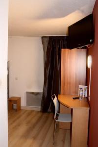 TV/Unterhaltungsangebot in der Unterkunft Brit Hotel Primo Colmar Centre
