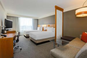 A bed or beds in a room at Hyatt Place San Jose, Downtown