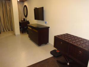 A television and/or entertainment centre at Pride Ananya Resorts