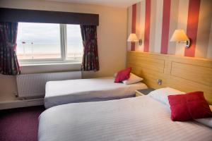 A bed or beds in a room at Viking Hotel- Adults Only