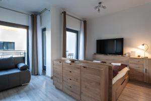 A television and/or entertainment center at Royal Exclusive Apartments in Centre