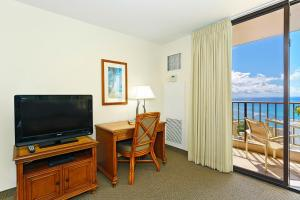 A television and/or entertainment center at Waikiki Sunset #3708