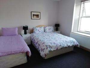 A bed or beds in a room at The River House Self Catering Apartment
