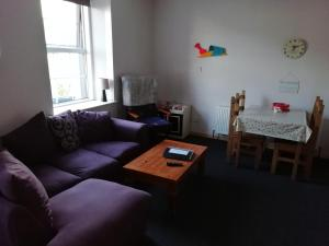 A seating area at The River House Self Catering Apartment
