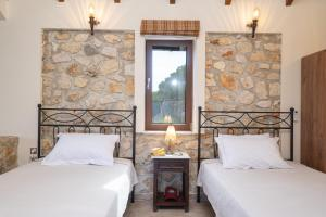A bed or beds in a room at BRAND NEW: Villa Bolios, Sea View, Private Pool