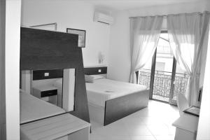 A bed or beds in a room at La Dea dell'Abbondanza