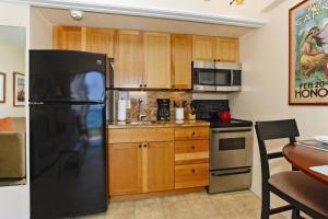 A kitchen or kitchenette at Waikiki Park Heights #1711