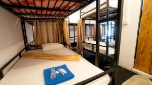 A bunk bed or bunk beds in a room at Orchid Resort