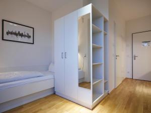 A bed or beds in a room at myroom - Serviced Apartments