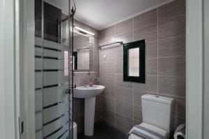 A bathroom at Anastasia Apartments