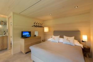 Ein Bett oder Betten in einem Zimmer der Unterkunft Gartenstudio Waldblick