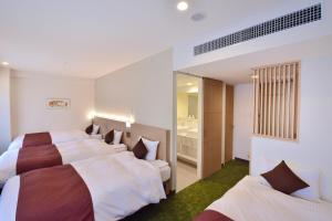 A bed or beds in a room at Hotel KSP