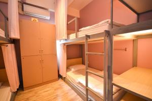 A bunk bed or bunk beds in a room at Good Day Hostel
