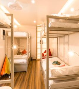 A bunk bed or bunk beds in a room at Dreams Hostel center