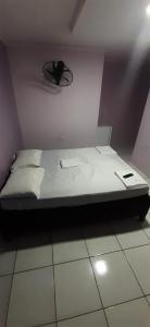 Cama ou camas em um quarto em Pousada Acauã