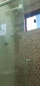 Um banheiro em Pousada Acauã