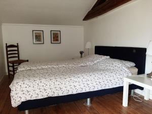 Un ou plusieurs lits dans un hébergement de l'établissement Cozy Hoiday Home in Droyes North France with Terrace