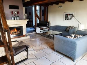 Coin salon dans l'établissement Cozy Hoiday Home in Droyes North France with Terrace