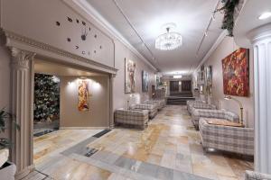 Лобби или стойка регистрации в Марко Поло Пресня Отель