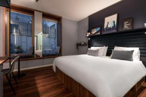 A bed or beds in a room at A-STAY Antwerp