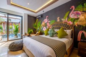 A bed or beds in a room at The Akasha Boutique Hotel