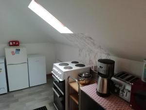 A kitchen or kitchenette at The River House Hostel