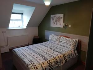 A bed or beds in a room at The River House Hostel