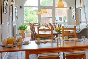 Ein Restaurant oder anderes Speiselokal in der Unterkunft Elbhof Harnisch