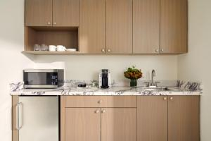 A kitchen or kitchenette at Loews Regency New York Hotel