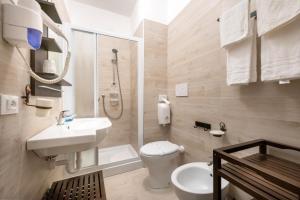 Koupelna v ubytování Hotel Tizian Beach