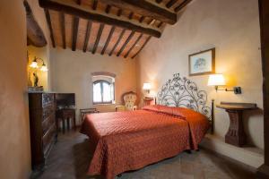 Letto o letti in una camera di Camere Dentro Il Castello