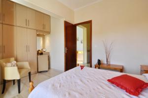 A bed or beds in a room at Marilena Studios And Apartments