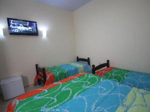 Cama ou camas em um quarto em Pousada Kekanto