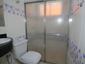 Um banheiro em Pousada Kekanto