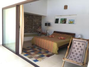 A bed or beds in a room at Dhole's Den Bandipur