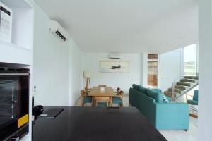 A kitchen or kitchenette at AQ-VA Hotel & Villas
