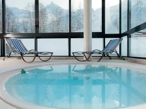 The swimming pool at or near Mercure Chamonix Les Bossons