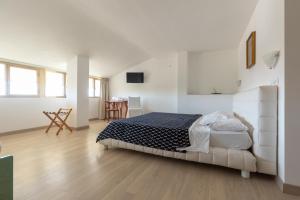 Ein Bett oder Betten in einem Zimmer der Unterkunft Hotel Cavallino Bianco