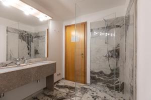 Ein Badezimmer in der Unterkunft Hotel Cavallino Bianco
