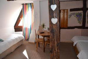 A bed or beds in a room at Hôtel le Saint Nicolas
