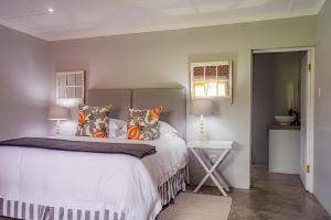 A bed or beds in a room at Springvale Farm