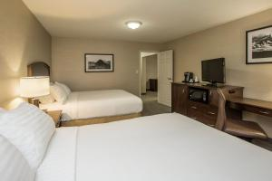 A bed or beds in a room at Holiday Inn Lethbridge