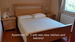 A bed or beds in a room at Apartment Marica Amazing View