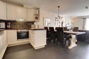 Kjøkken eller kjøkkenkrok på Bergo Hotel, Apartments and Cottages