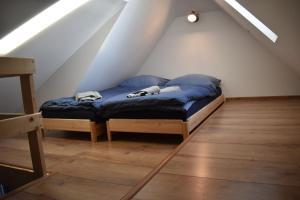 Postel nebo postele na pokoji v ubytování Penzion Beskydkrby