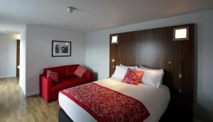 A bed or beds in a room at Ramada Encore Newcastle-Gateshead