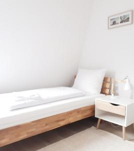 Ein Bett oder Betten in einem Zimmer der Unterkunft Hotel Calenberger Hof