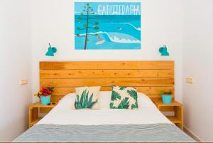 A bed or beds in a room at Nexo Surf House
